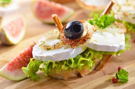 sliced cheese: Goat cheese snack with figs Stock Photo