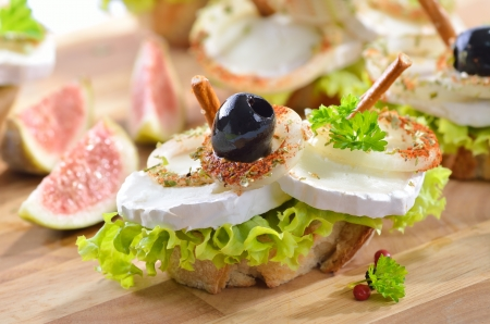 goat cheese: Goat cheese snack with figs Stock Photo