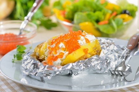 Jacket potato with spiced curd cheese and trout caviar photo