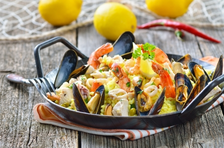 Tasty Spanish paella with seafood and chicken breast photo