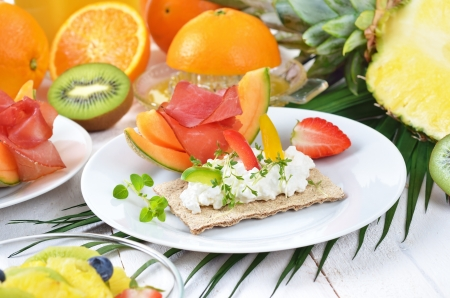 Healthy breakfast with fresh fruit, crispbread, lean ham and cottage cheese