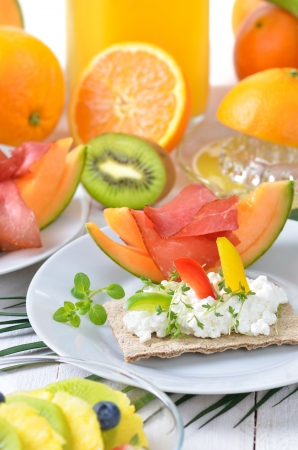 Healthy breakfast with fresh fruit, crispbread, lean ham and cottage cheese photo