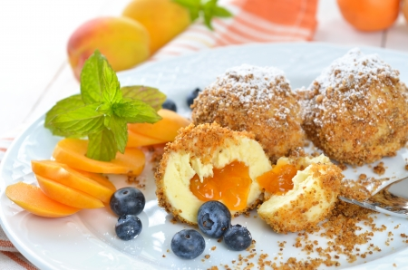 Sweet apricot dumplings with some blueberries Stock Photo - 20919098