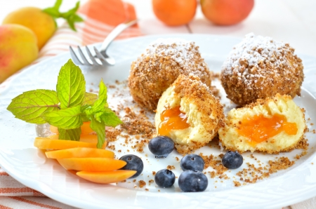 Sweet apricot dumplings with some blueberries photo