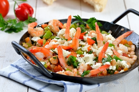 Greek saganaki with shrimps, vegetables and feta cheese