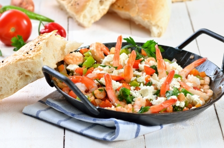 Greek saganaki with shrimps, vegetables and feta cheese Stock Photo - 21478922