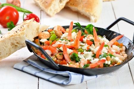 Greek saganaki with shrimps, vegetables and feta cheese Stock Photo - 21478922