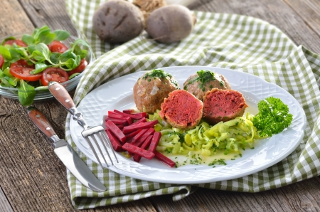 South Tyrolean beetroot bread dumplings on leeks Stock Photo - 22023138