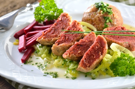 South Tyrolean beetroot bread dumplings on leeks Stock Photo - 22023142