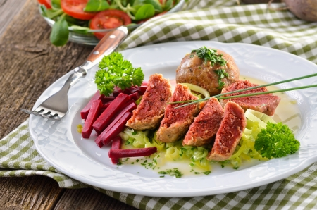 South Tyrolean beetroot bread dumplings on leeks Stock Photo - 22023141