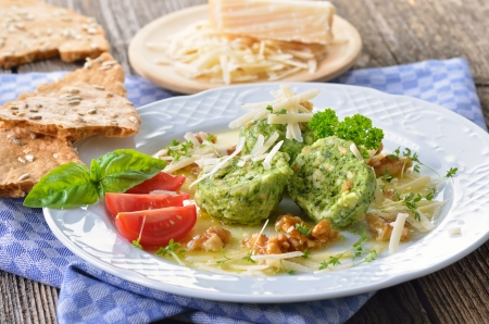 South Tyrolean bread dumplings with spinach and cheese Reklamní fotografie - 22023144