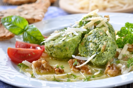 South Tyrolean bread dumplings with spinach and cheese photo