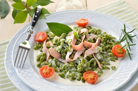 Tyrolean spinach spaetzle with parmesan cream sauce and ham photo