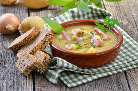 meat soup: Freshly made potato soup with bacon strips and Vienna sausage wheels Stock Photo