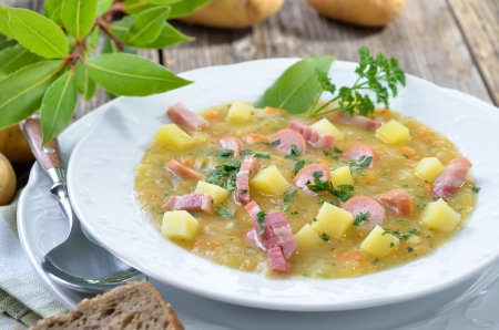 sausage pot: Freshly made potato soup with bacon strips and Vienna sausage wheels Stock Photo