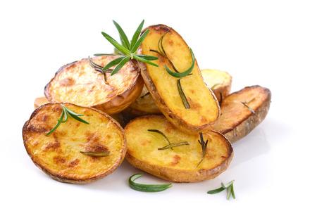 Pommes de terre non pelées cuites au four avec du romarin Banque d'images - 25998524