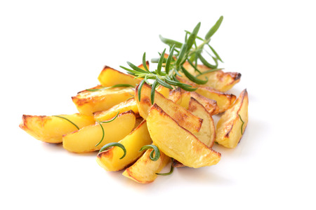 Baked potato wedges with rosemary on a white