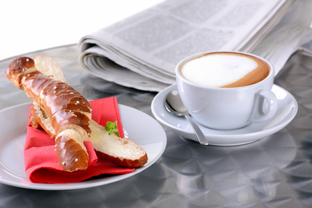 pretzel: Pretzel breadstick with butter and a cup of cappuccino  Stock Photo