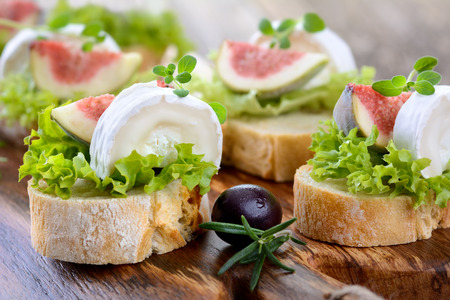 buffet lunch: Finger food with goat cheese and figs Stock Photo