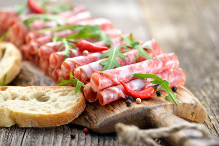 italian salami: Italian salami from Tuscany served on a wooden board