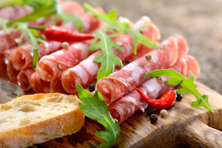 Italian salami from Tuscany served on a wooden board