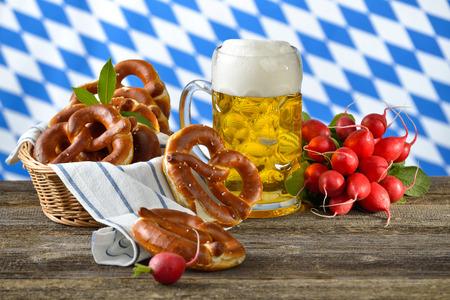 pretzels: Fresh red radishes and pretzels Bavarian beer