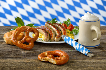 tankard: Fried Bavarian sausages on potato salad served with pretzels and Bavarian beer in a tankard