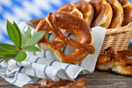 Fresh Bavarian pretzels The Bavarian flag in the background