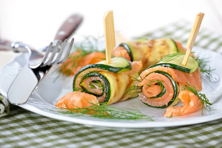 Delicious rolls of fried zucchini slices and smoked salmon with dill Reklamní fotografie - 44161217