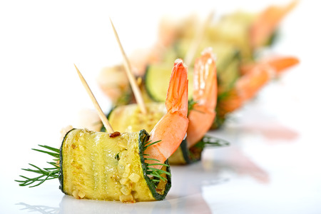 downloaded: Delicious rolls of fried zucchini slices and prawns with dill