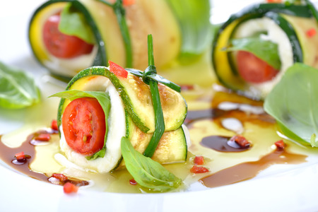 Caprese wrapped with fried zucchini slices, tied and knotted with chives Reklamní fotografie