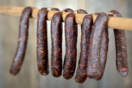 Typical dark smoked sausages from South Tyrol, so-called