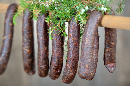 air dried: Cured sausages from South Tyrol with juniper branches