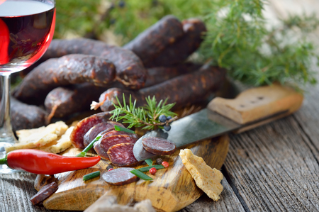 air dried: South Tyrolean snack with typical cured sausages and very crispy flatbread, served with a glass of red wine