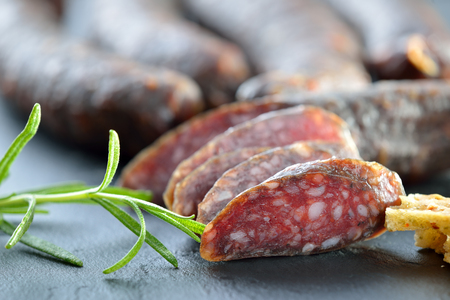 air dried salami: South Tyrolean snack with cured sausages typical so-called smoked sausages and very crispy bread served on a slate flat