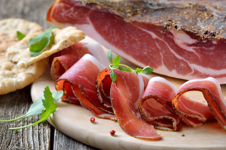 sliced: South Tyrolean bacon, a regional specialty, prepared to traditional recipes .According, Often served with the Tyrolean crispy flatbread