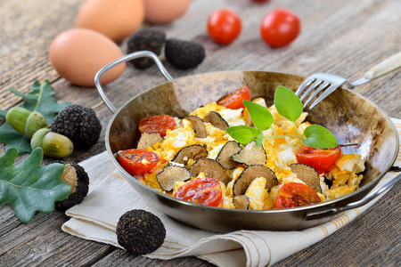 downloaded: Scrambled eggs with fresh black truffles from France served in a frying pan Stock Photo