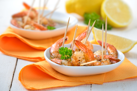 toothpick: Spanish tapas - spicy fried prawns with olive oil, sherry and garlic