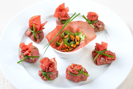 tied up: Italian bresaola beef ham stuffed with chopped rocked salad, roasted pine nuts, parmesan cheese and creamy balsamic vinegar, tied up with blanched chives