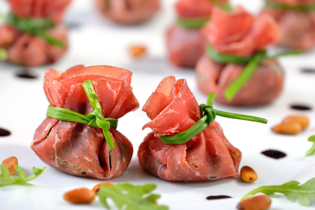 rocked: Italian bresaola beef ham stuffed with chopped rocked salad, roasted pine nuts, parmesan cheese and creamy balsamic vinegar, tied up with blanched chives