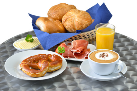 breakfast cup: Mixed breakfast with a cup of cappuccino on a round table bistro