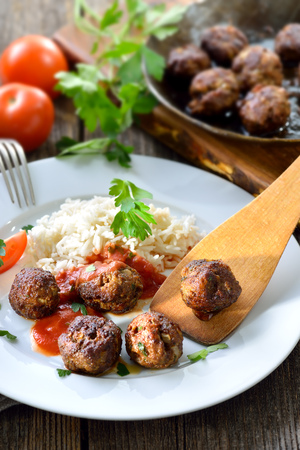 meat dish: Crispy roasted meatballs with Basmati rice and tomato sauce