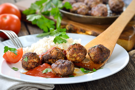 grilled meat: Crispy roasted meatballs with Basmati rice and tomato sauce