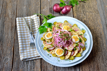gherkins: Bavarian bread dumpling salad with onion rings, radishes, spring onions, sliced eggs and gherkins, dressed with oil and apple vinegar and some herbs