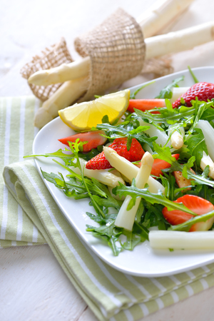 downloaded: Colorful spring salad with fresh white asparagus, rocketsalad and strawberries Stock Photo