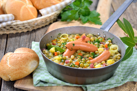 downloaded: Hearty pea stew with potatoes, bacon and Viennese sausages