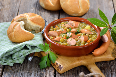 Hearty pea stew with potatoes, bacon and Viennese sausages
