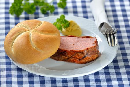 leberkaese: Portion of oven fresh Bavarian meat loaf with a crispy roll and mustard
