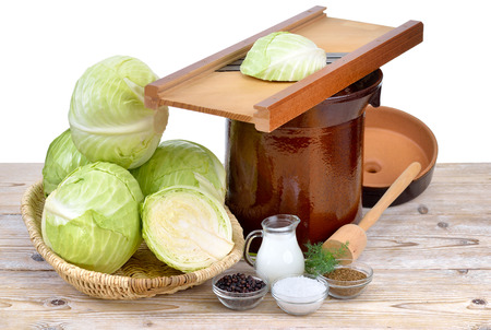 crock pot: Food fermentation, preparation for making Sauerkraut: German white cabbage, caraway seeds, juniper berries, salt, whey, dill, a shredder, a tamper and a crock pot