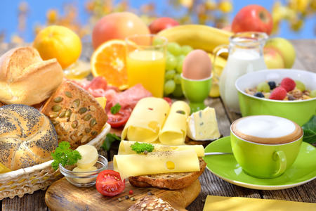 sky brunch: Outside served breakfast with a cup of cappuccino and a large selection of food